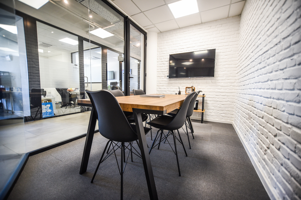 long table with black chairs in a meeting room in Strand