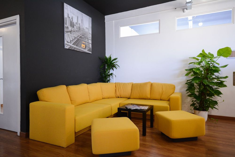 yellow sofa in a chill out area in St Julian`s